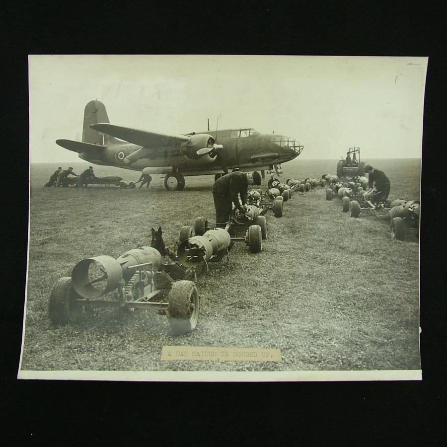 Press photograph - bomb loading