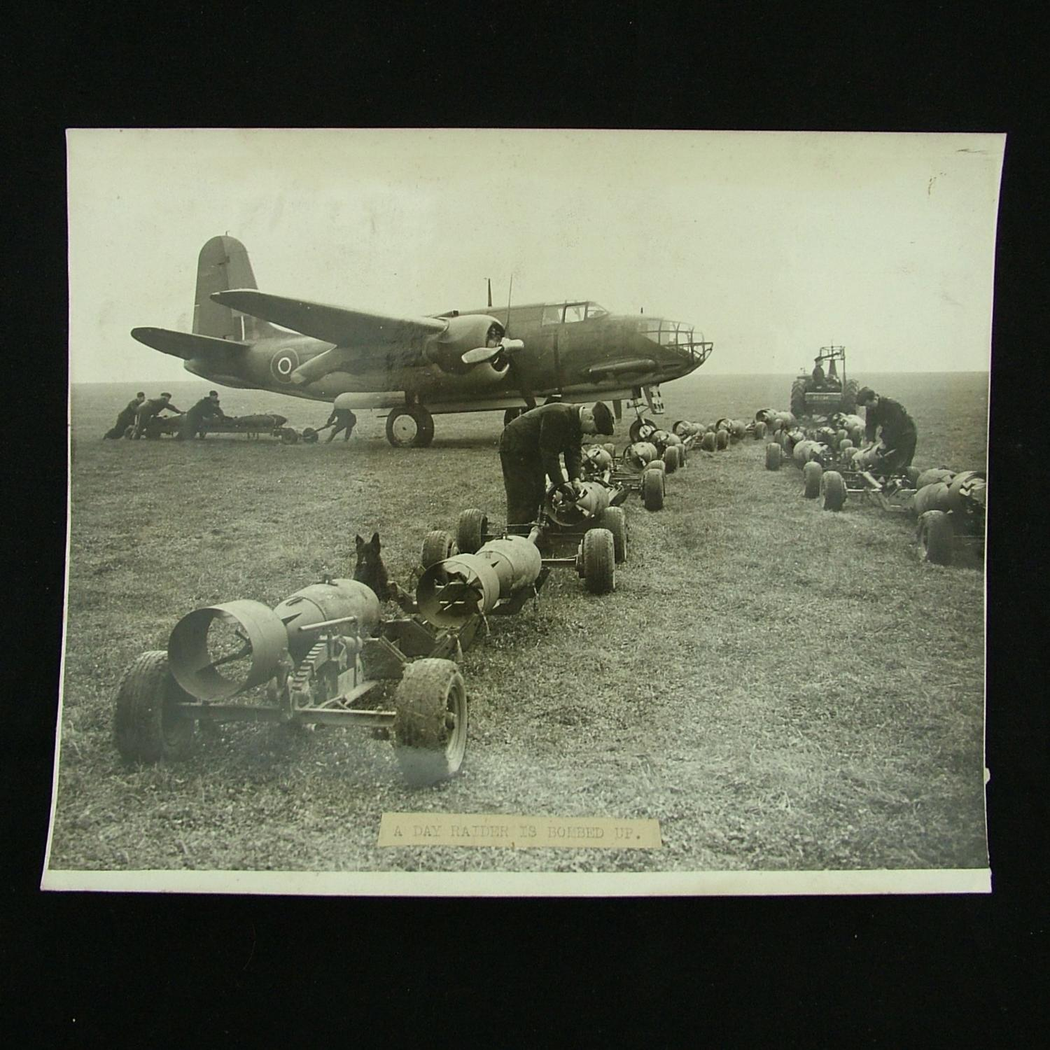 Press photograph - bomb loading