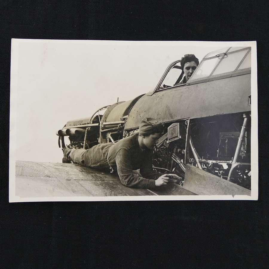 Press photo - WAAFs work on a Hurricane