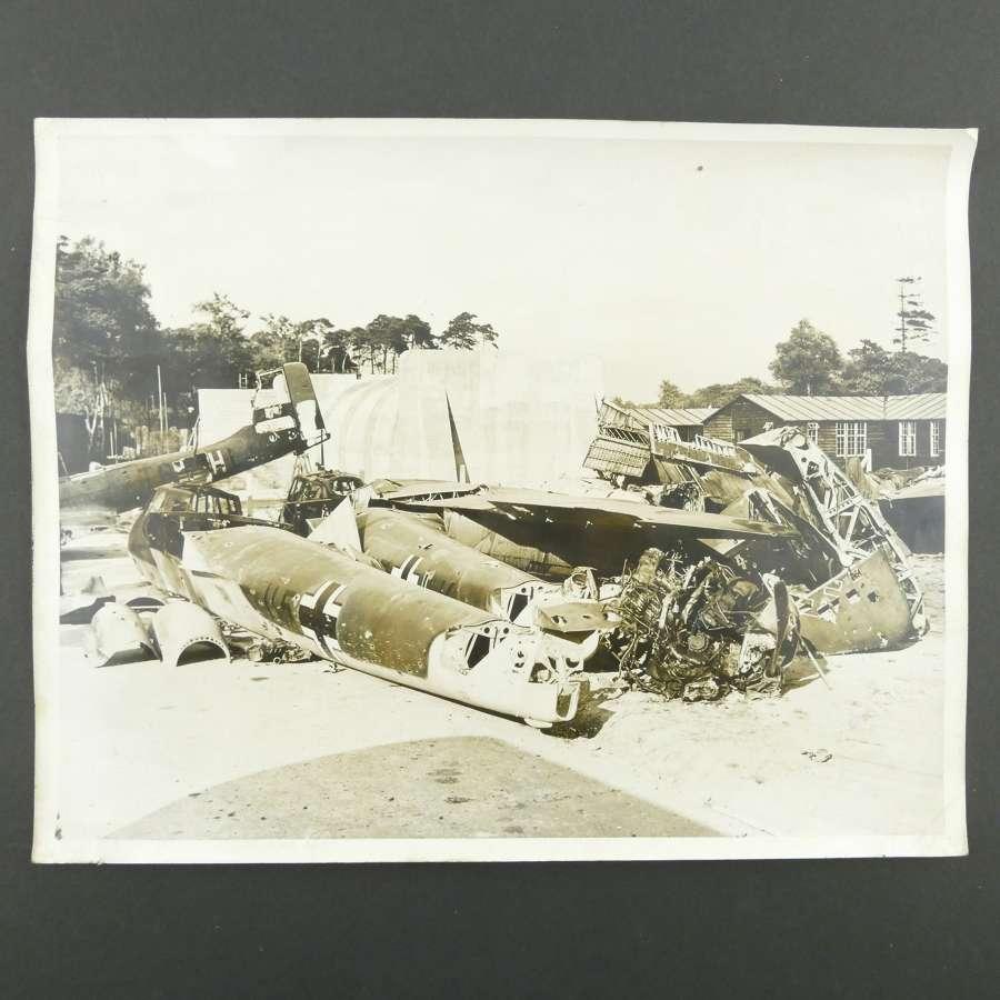 Press photograph - wrecked Luftwaffe aircraft on RAF station
