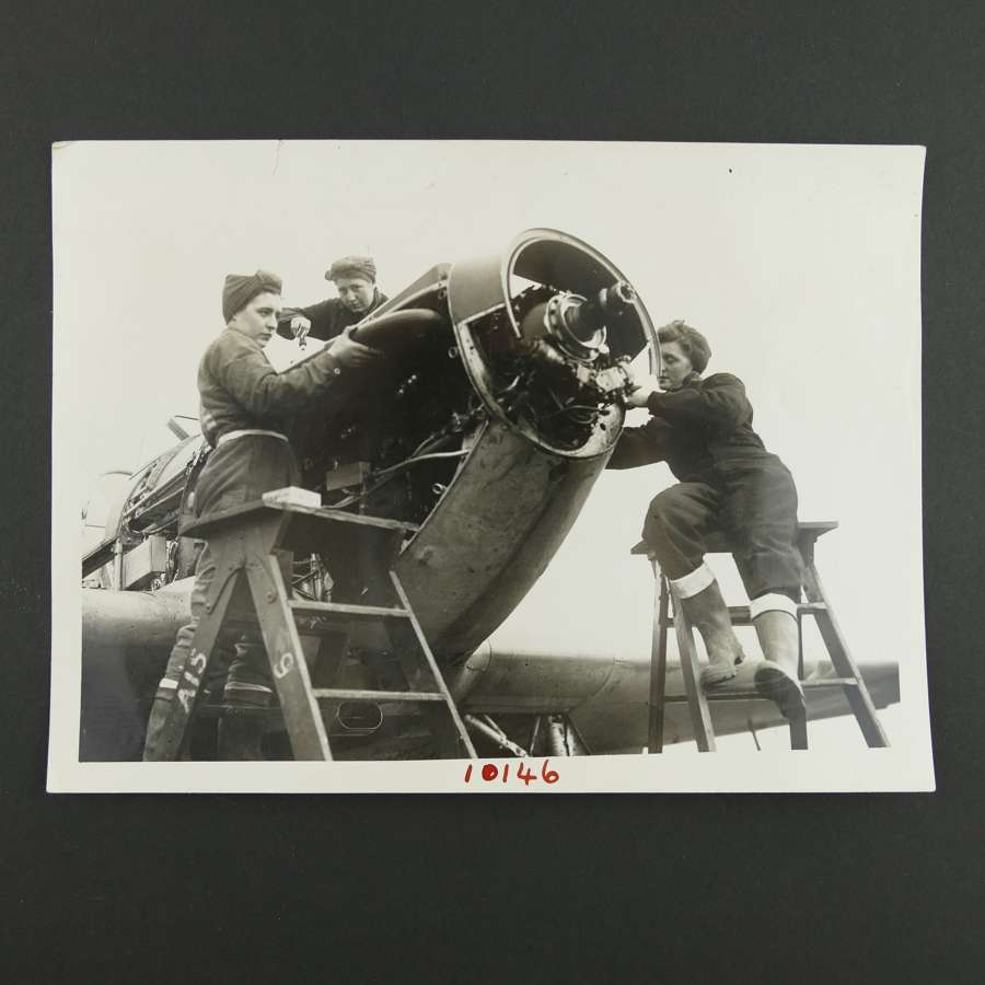 Press photo - WAAF flight mechanics work on a Hurricane