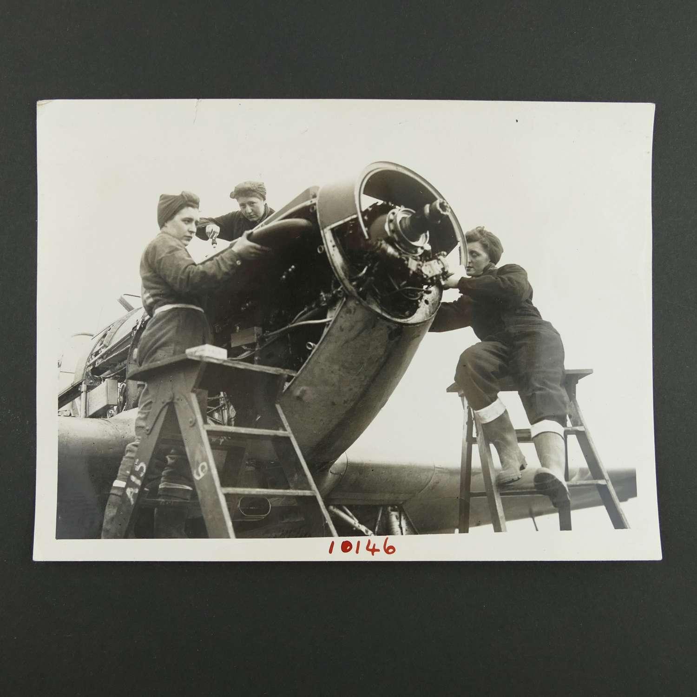 Press photo - WAAF flight mechanics work on a Hurricane