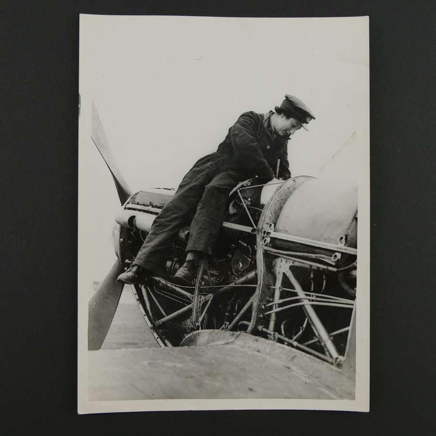 Press photo - WAAF mechanic working on a Hurricane fighter