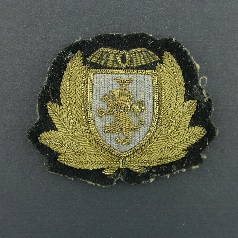Caledonian Airways cap badge